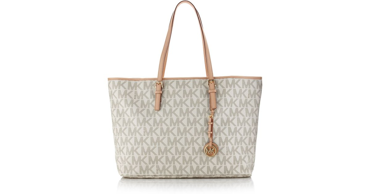 d1339be5391a Lyst - MICHAEL Michael Kors Jet Set Logo Laptop Travel Tote in Natural