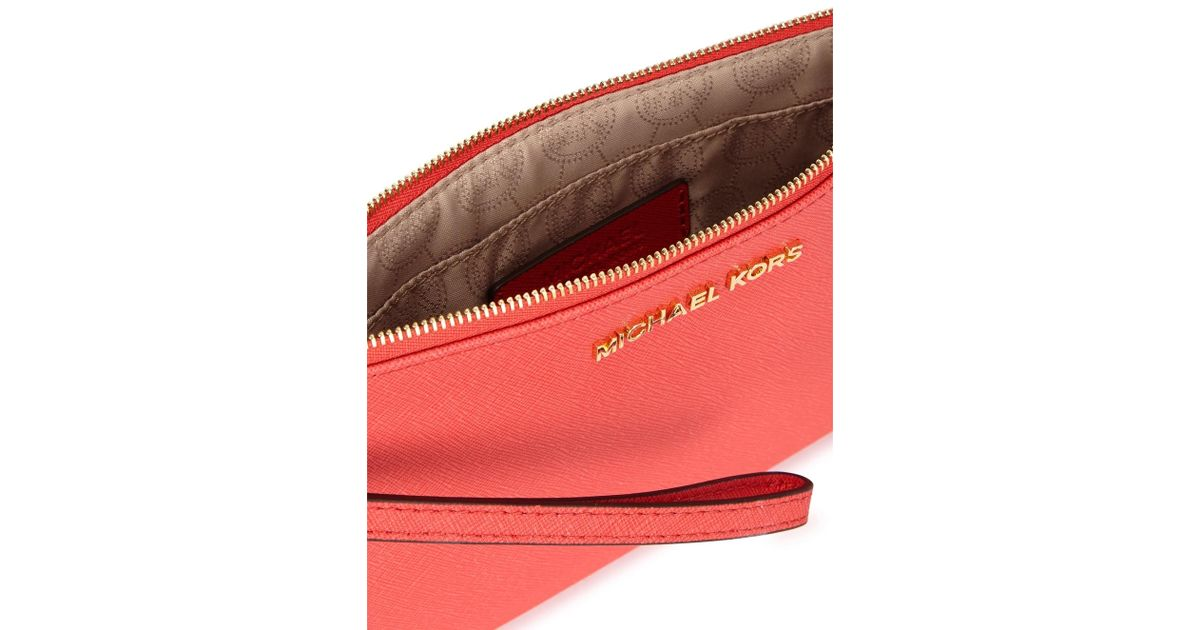 bccb21acef7f87 Michael Kors Jet Set Travel Coral Leather Clutch in Pink - Lyst
