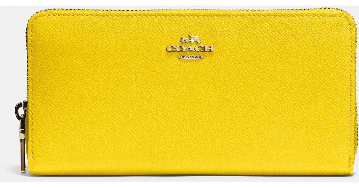 fcee22d38c Lyst - COACH Accordion Zip Wallet In Crossgrain Leather in Yellow