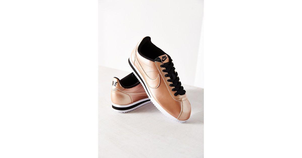save off 3084d def36 Nike Women's Classic Cortez Leather Sneaker in Metallic - Lyst