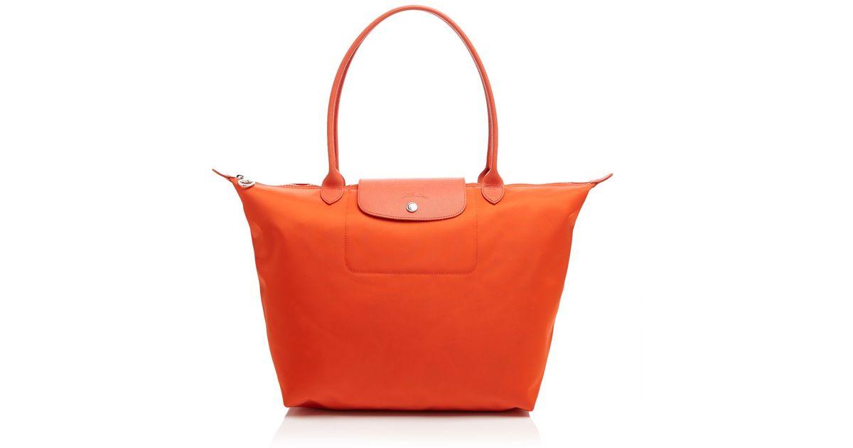 789aa5dff435e Lyst - Longchamp Tote - Le Pliage Neo Large in Orange