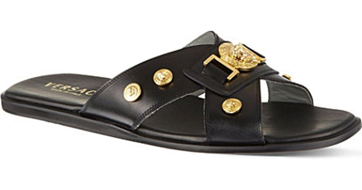 b3c78575c2cf Lyst - Versace Mini Medusa Cross-strap Sandals in Metallic