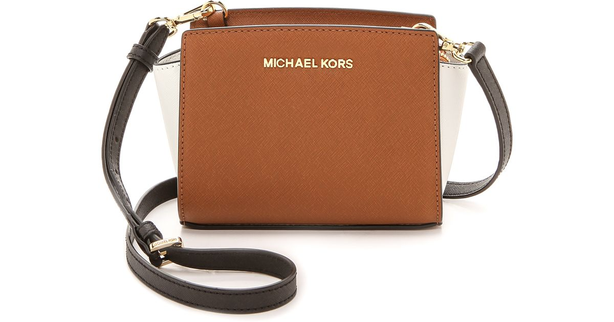 7d1ca0031811 ... italy lyst michael michael kors colorblock selma mini messenger bag  luggagewhiteblack in brown 92dab 92b84