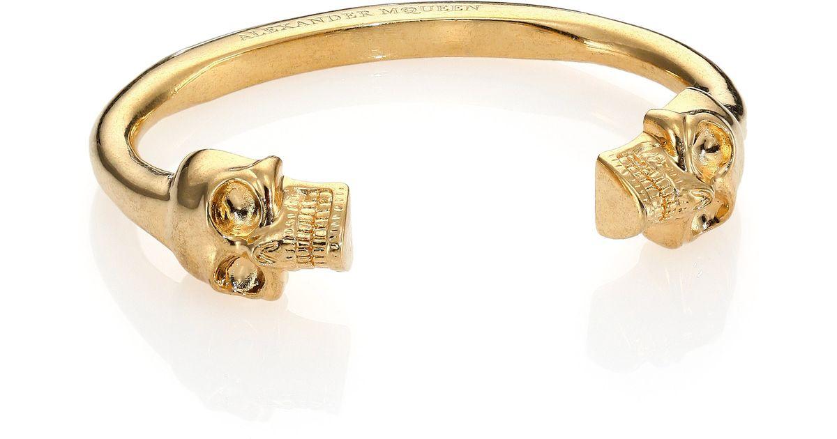 Twin Skull Cuff Bracelet In Pale Gold
