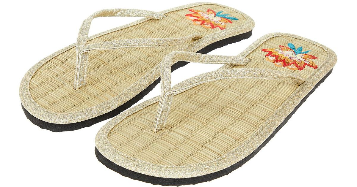 3e0bf6327080 Accessorize Lotus Embroidered Seagrass Flip Flops in Metallic - Lyst