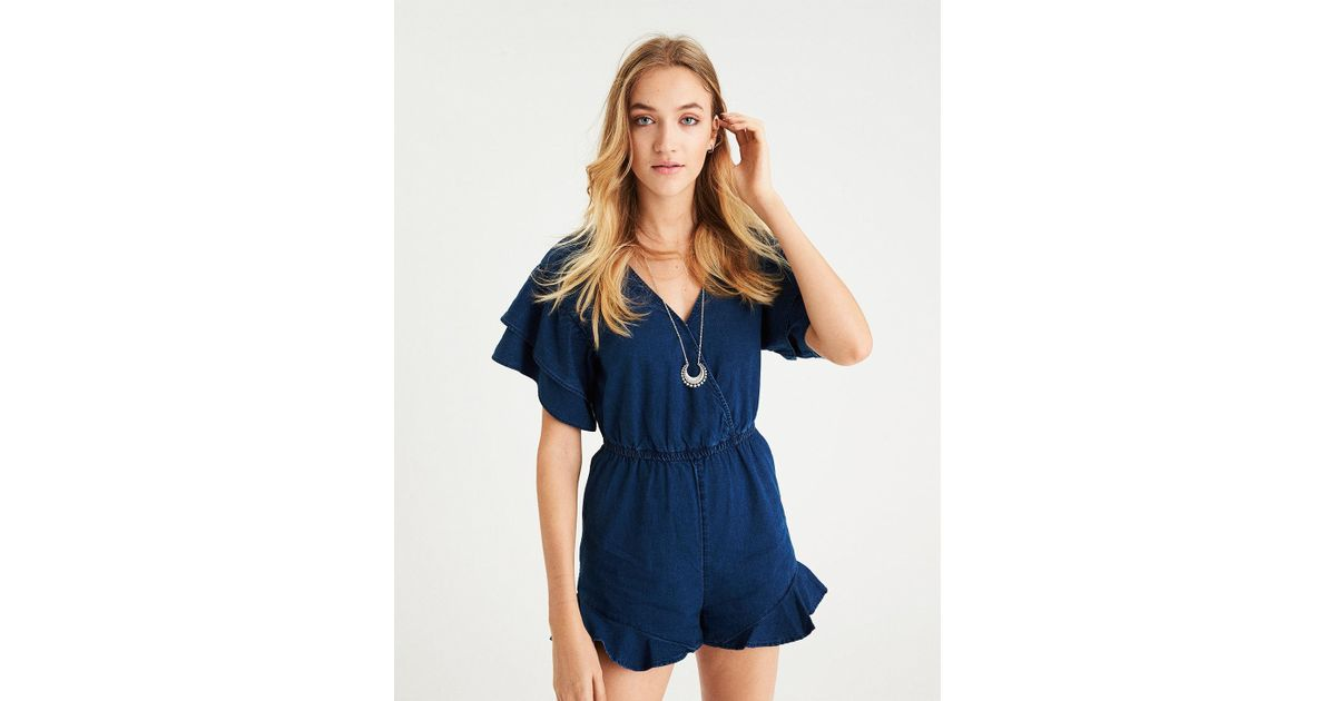 d0e331a13c68 Lyst - American Eagle Ae Surplice Ruffle Denim Romper in Blue