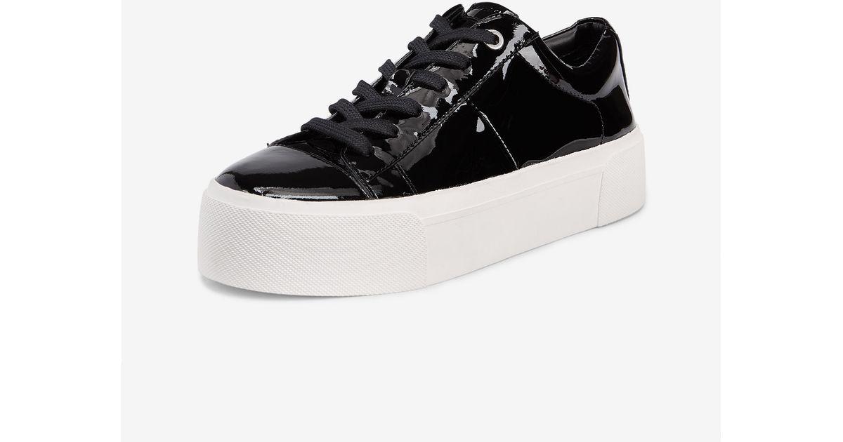 b9fbbd0058a Lyst - DKNY Bari Patent Platform Sneaker in Black