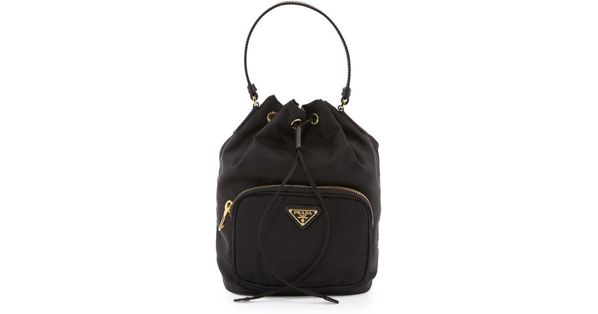 5d6103b953bf ... low price lyst prada tessuto mini bucket crossbody bag in black 8db0f  b3692
