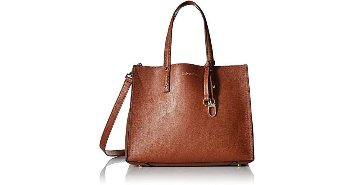 ff5dfcff475a2 Lyst - Calvin Klein Faux Leather Small East west Tote in Brown
