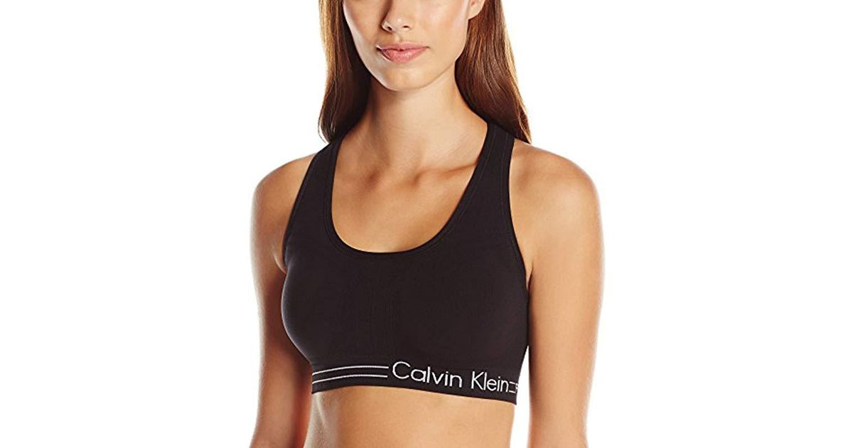 a42b2e835104c Lyst - Calvin Klein Medium Impact Bra W rem. Cups in Black - Save 19%