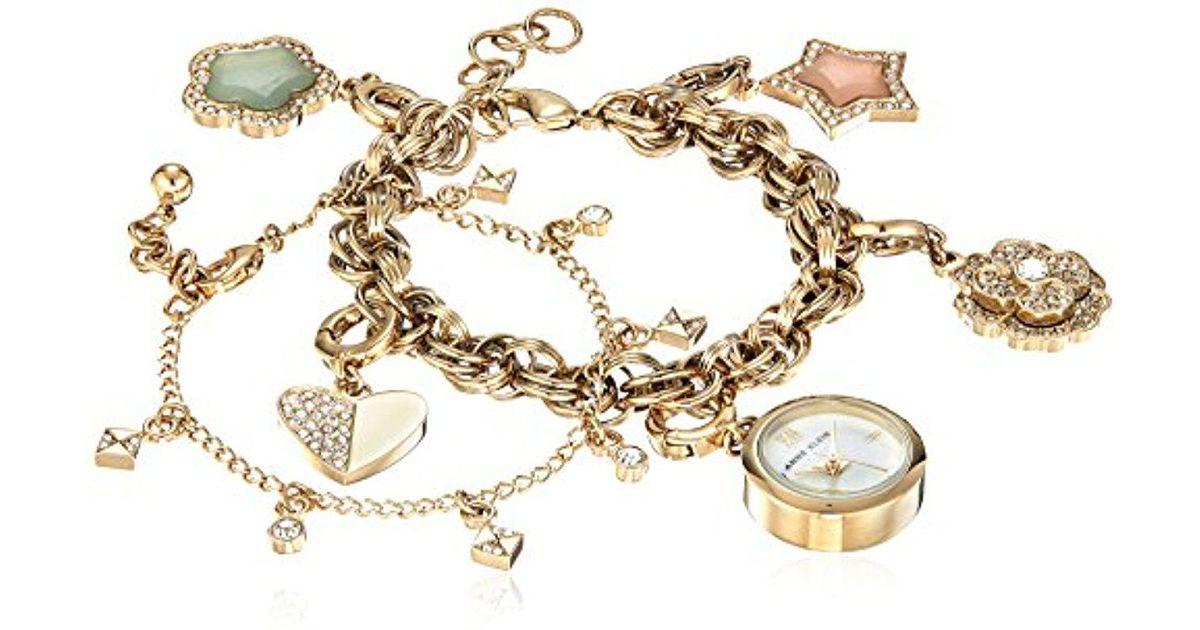 Anne Klein Metallic Ak 3044chst Swarovski Crystal Accented Gold Tone Charm Watch And Bracelet Set