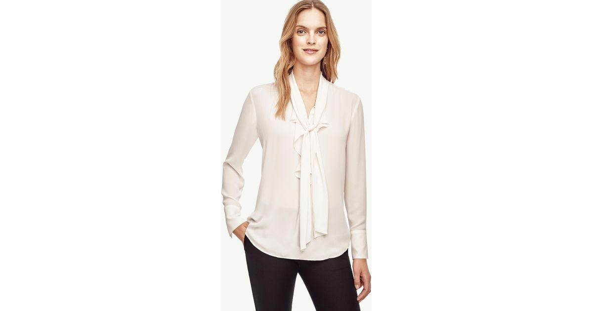 f4d5dbe9ae1549 Ann Taylor Petite Tie Neck Ruffle Blouse in White - Lyst