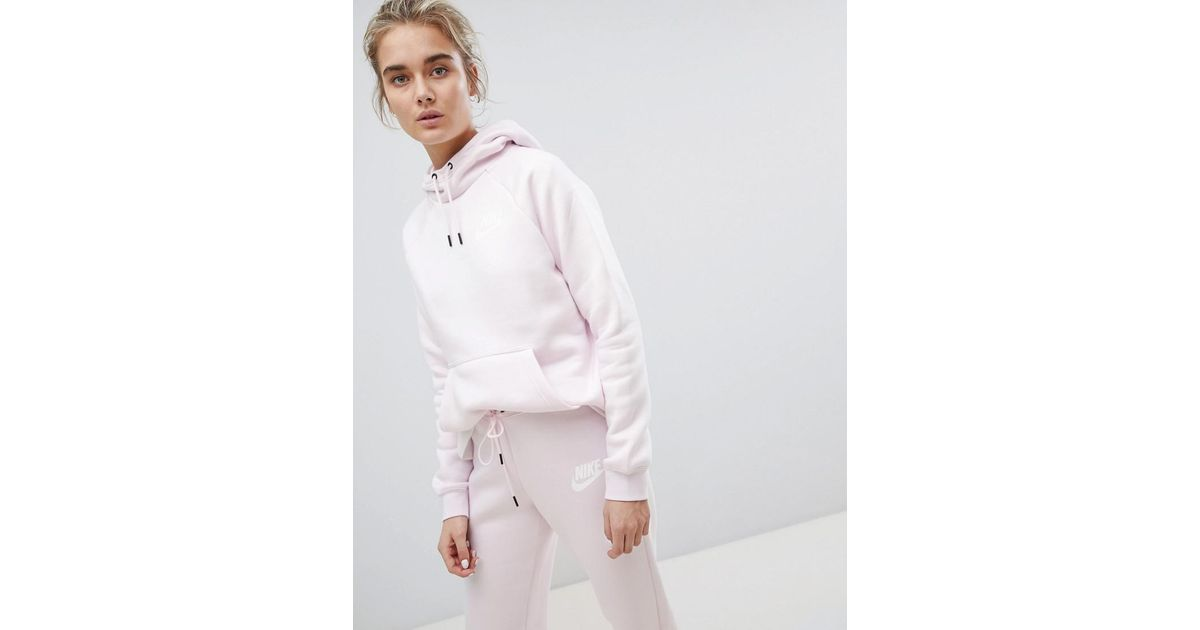 store many fashionable new high quality Nike Rally Pullover Hoodie In Pearl Pink