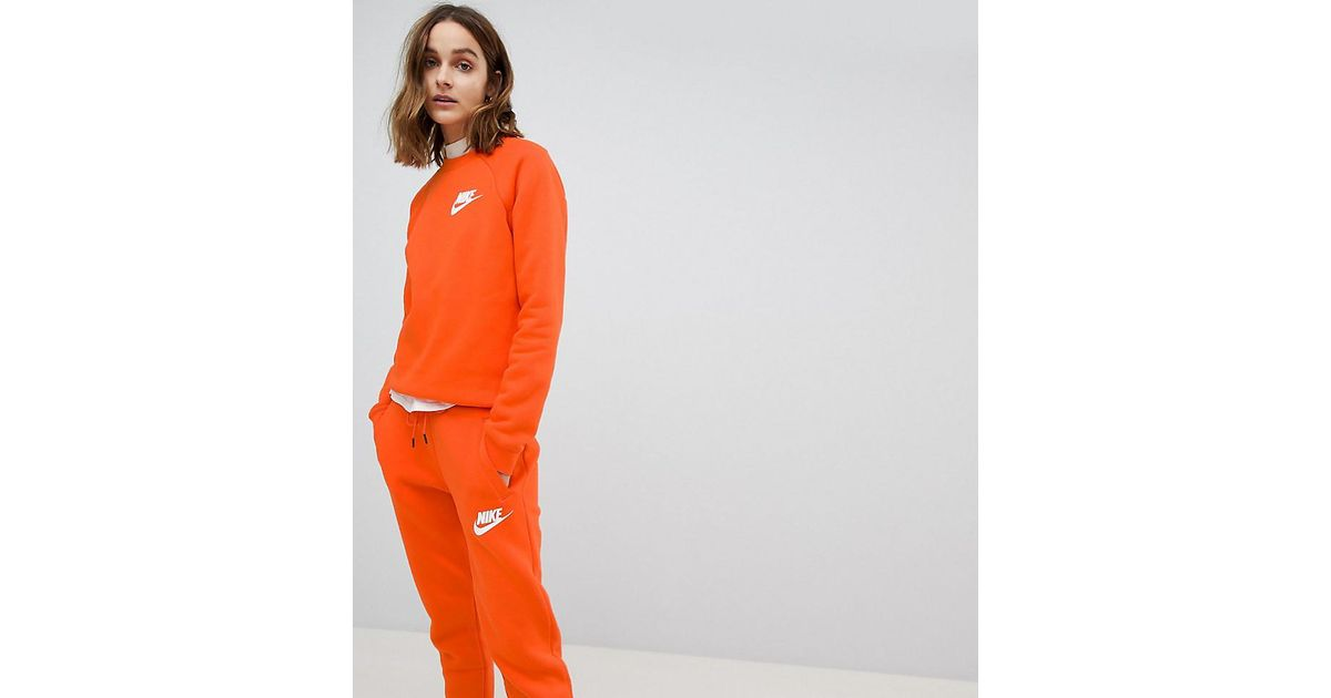 100% top quality the latest first look Nike Exclusive To Asos Rally Joggers In Orange