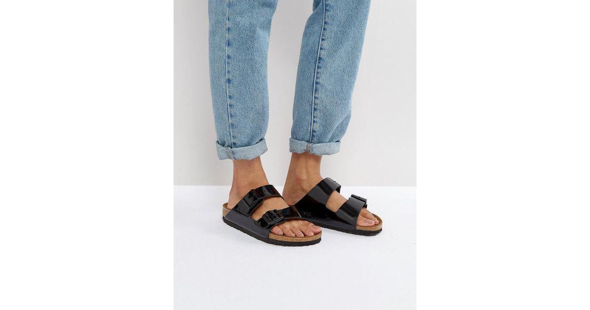 0b6d9c9014736a Birkenstock Arizona Birko Black Patent Flat Sandals in Black - Lyst