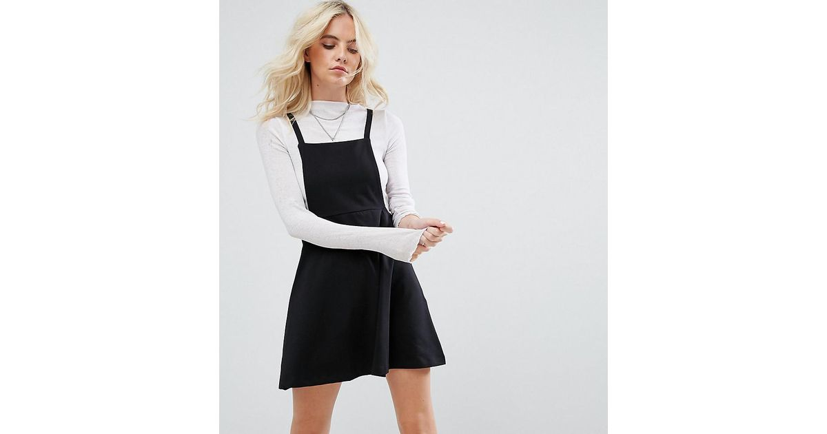7c08d7eae23 Lyst - ASOS Asos Design Petite Mini Pinafore Dress With Strappy Back in  Black