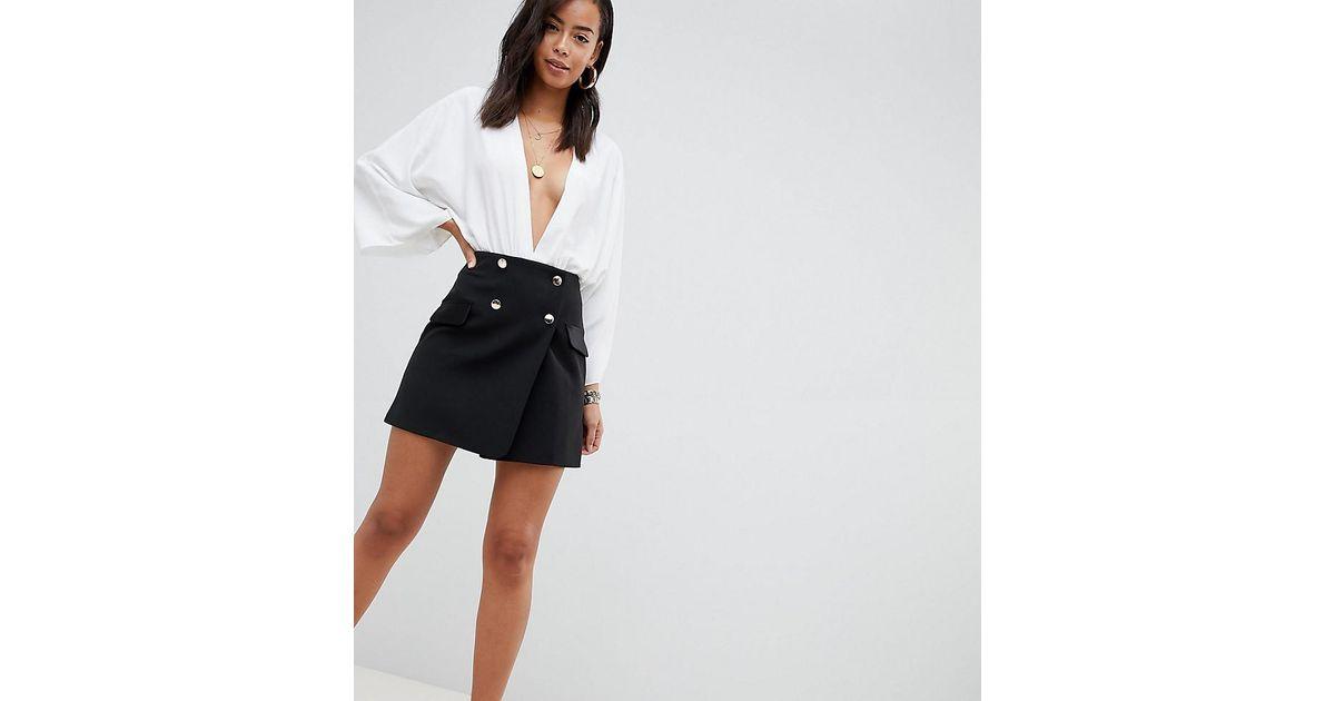 c3f11fc0ab0c80 Mini-jupe de smocking croise avec poches en satin ASOS en coloris Black