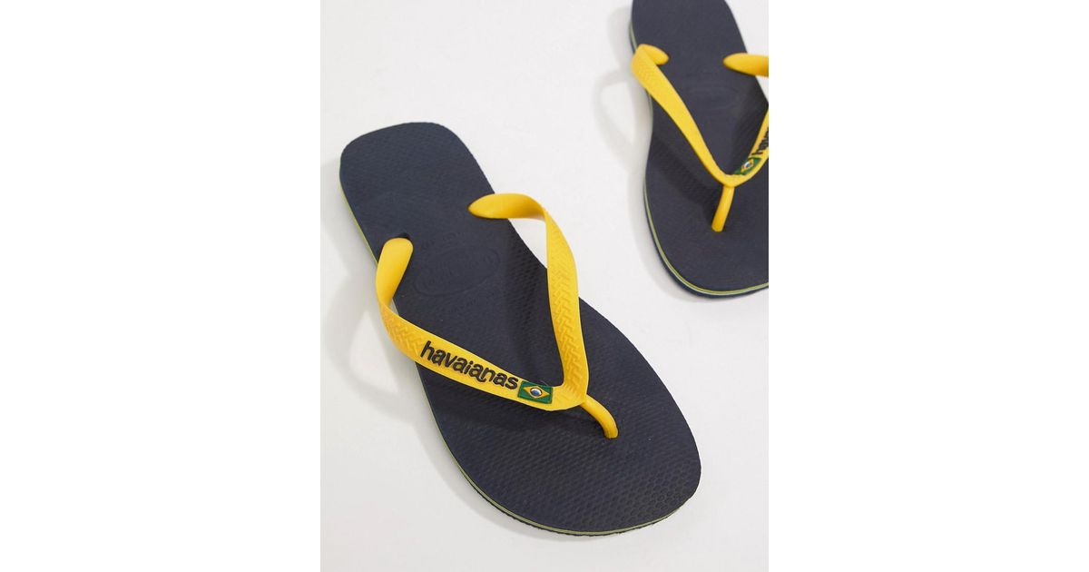 981e704c082abe Havaianas Brasil Logo Flip Flops In Navy And Yellow in Blue for Men - Lyst