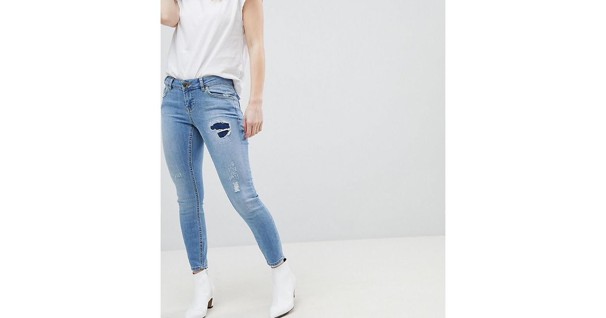 87f39d52d Lyst - ASOS Asos Design Petite Whitby Low Rise Skinny Jeans In Mid Wash Blue  With Rip And Repair in Blue