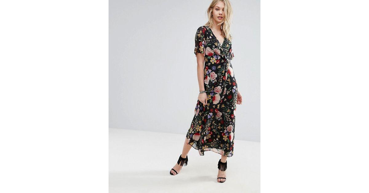 faff7a8556aae Mango Floral Wrap Midi Dress in Black - Lyst