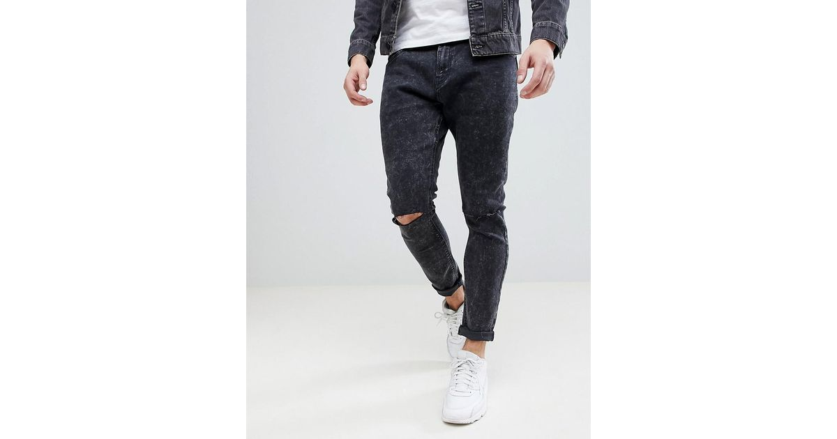 Lyst - Bershka Super Skinny Jeans With Ripped Knees In Black Wash in Black  for Men f68586be4333