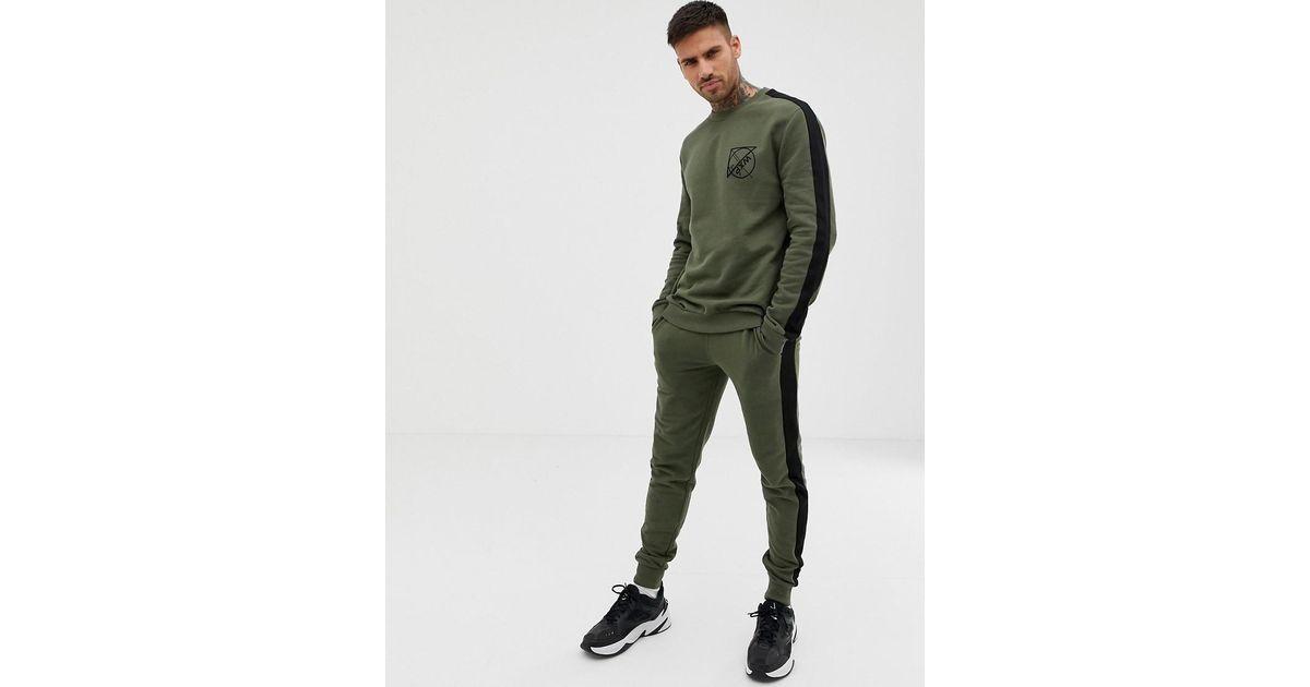 super cute wide range temperament shoes ASOS Trainingsanzug aus Sweatshirt und enger Jogginghose mit Schriftzug und  Seitenstreifen in Khaki in Green für Herren