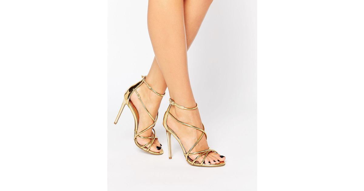 e0a391f9bca6 Lyst - Office Spindle Rose Gold Mirror Strappy Heeled Sandals in Metallic