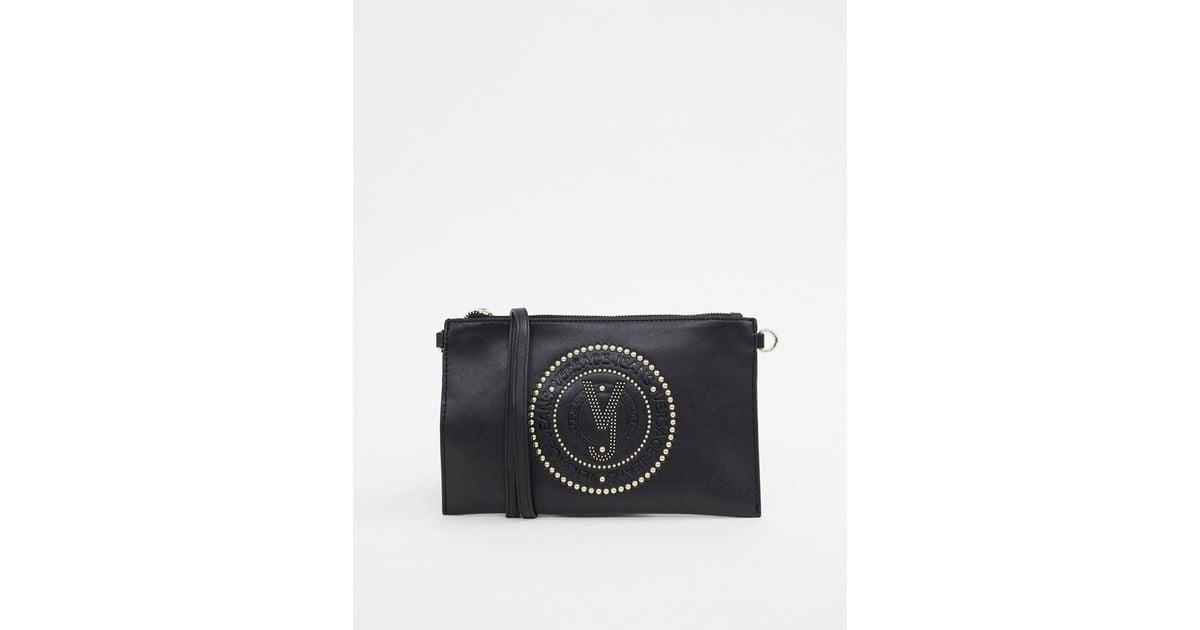 cc1fc7fb30 Versace Jeans Embossed Logo Crossbody Bag in Black - Lyst