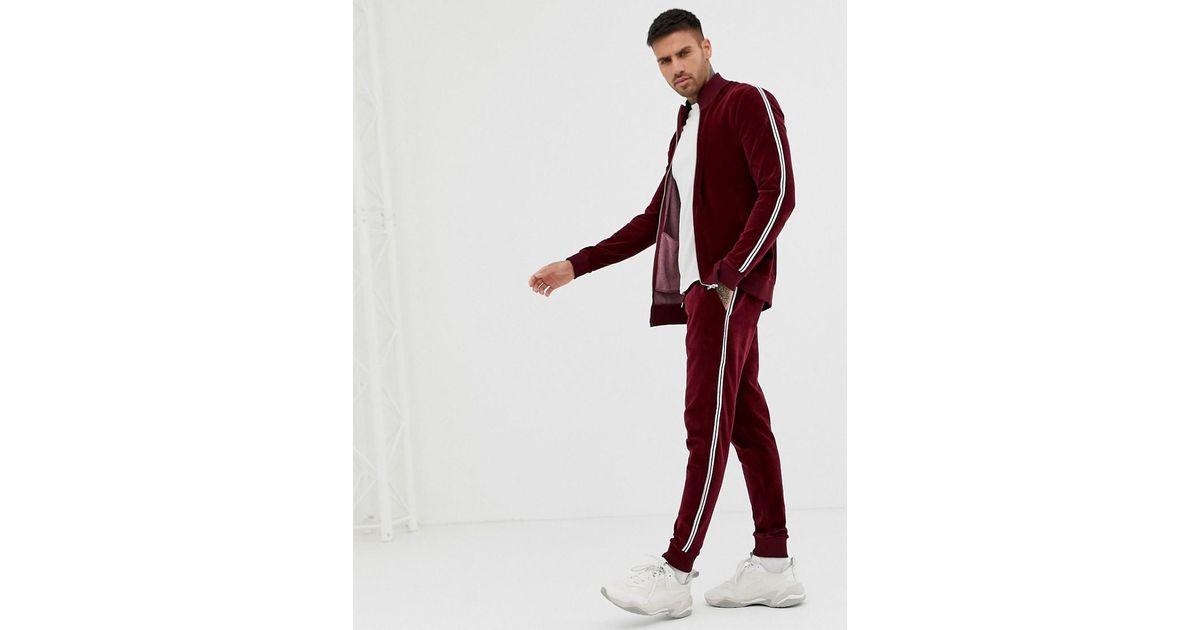 outlet on sale wide varieties promo code ASOS Baumwolle Trainingsanzug aus Velours mit Muskel ...
