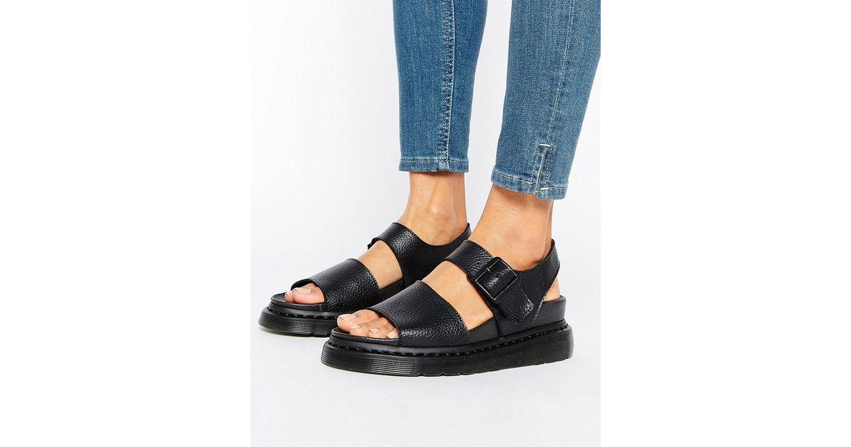 Lyst - Dr. Martens Romi Black Leather Strap Flat Sandals in Black 58d1bc031f1b