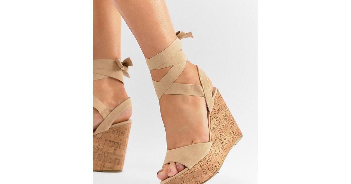 67f8425f07b Truffle Collection Tie Leg Wedges in Natural - Lyst