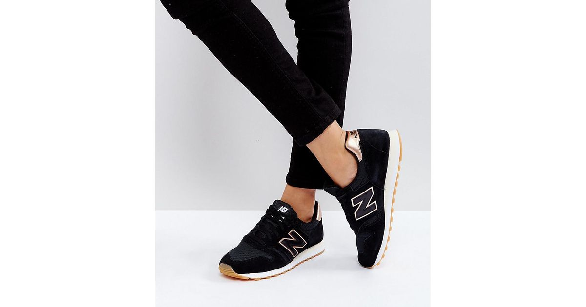 New Balance 373 Trainers In Black And Gold