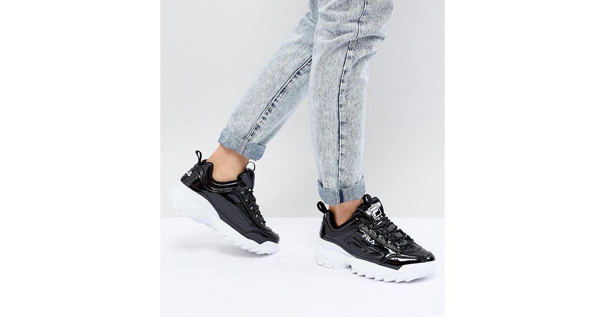 34a5bb44 Fila Disruptor Sneakers In Patent Black