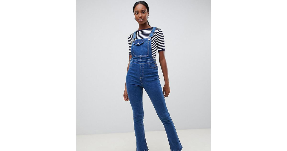 4ad9023e826 ASOS Asos Design Tall Denim Dungaree With Kickflare In Midwash Blue in Blue  - Lyst