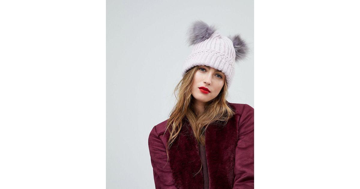 Lyst - River Island Faux Fur Double Pom Pom Beanie Hat in Purple