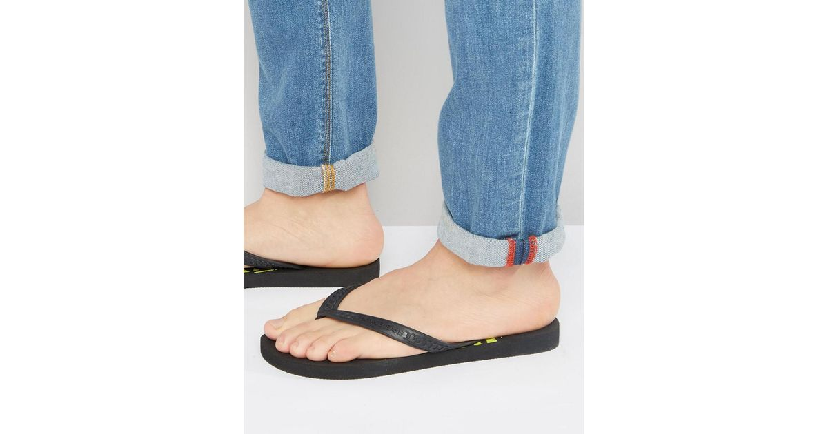 c29f93814cb6 Lyst - Versace Jeans Jeans Flip Flop With Logo In Black in Black for Men