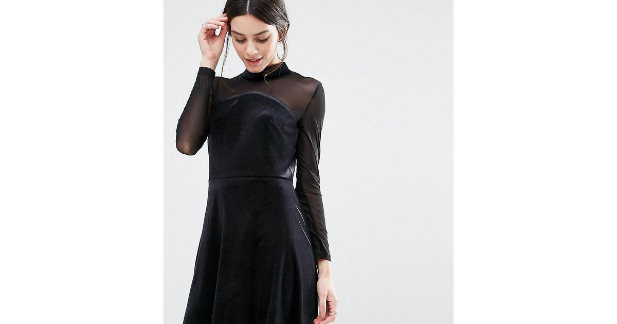 96334a410 True Decadence Mini High Neck Velvet Skater Dress With Mesh Sleeve Detail  in Black - Lyst