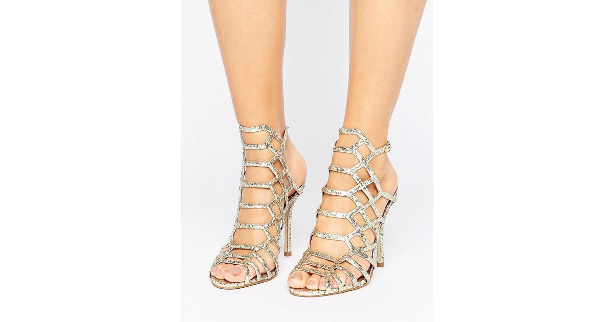 7f15687b3fa Steve Madden Metallic Slithur Gold Glitter Caged Heeled Sandals