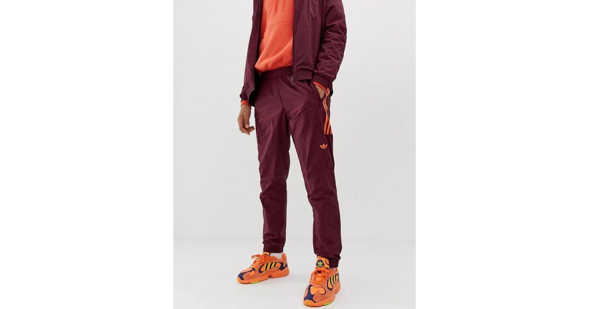 Red En Strike Pour Pantalon Rouge De Jogging Coloris Adidas Homme Flame Originals eWYH92IED