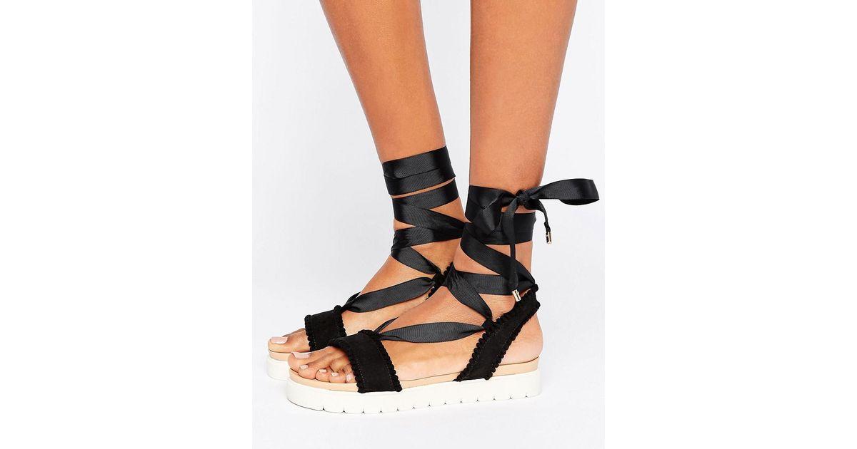a96189df88b Miss Kg Black Dakota Pom Pom Tie Up Flat Sandals