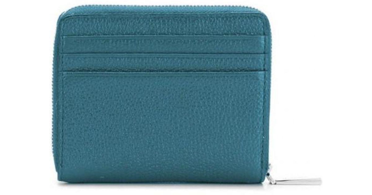 c062e1e205a3 Lyst - MICHAEL Michael Kors Michael Kors Luxe Teal Logo Zipped Snap Wallet  in Blue