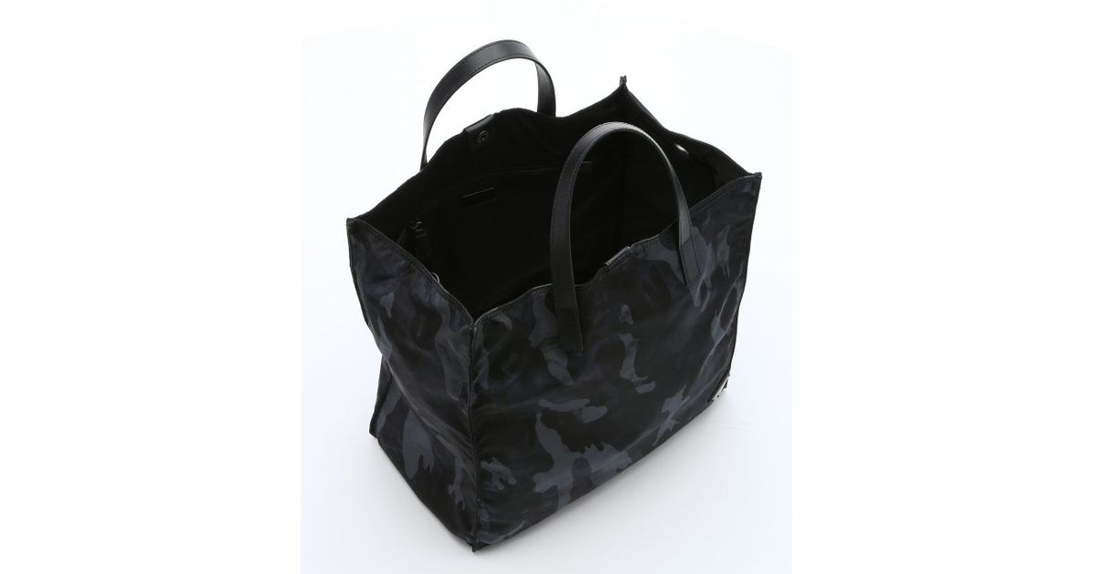 bd15d35d2f9c8b ... hot lyst prada blue saffiano leather and camo print nylon travel tote  in blue for men