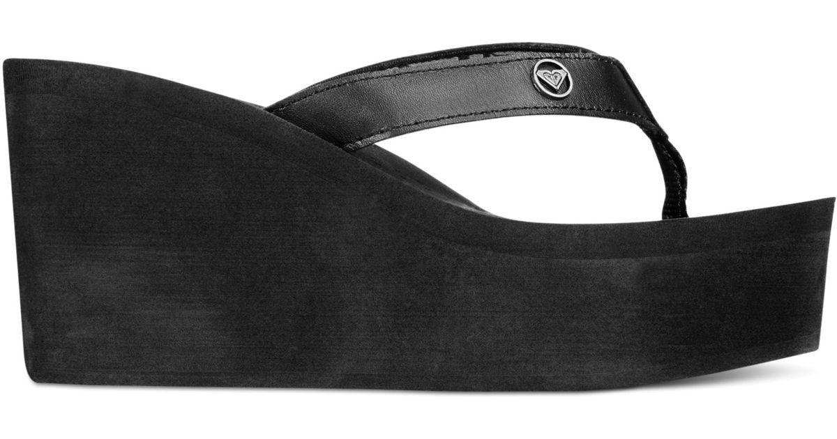 29a216c4090 Lyst - Roxy Palika Platform Wedge Flip Flops in Black