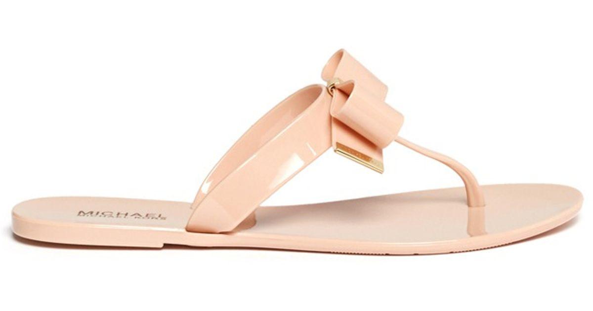 fcb7275b369 Lyst - Michael Kors Kayden Bow Thong Sandals in Pink