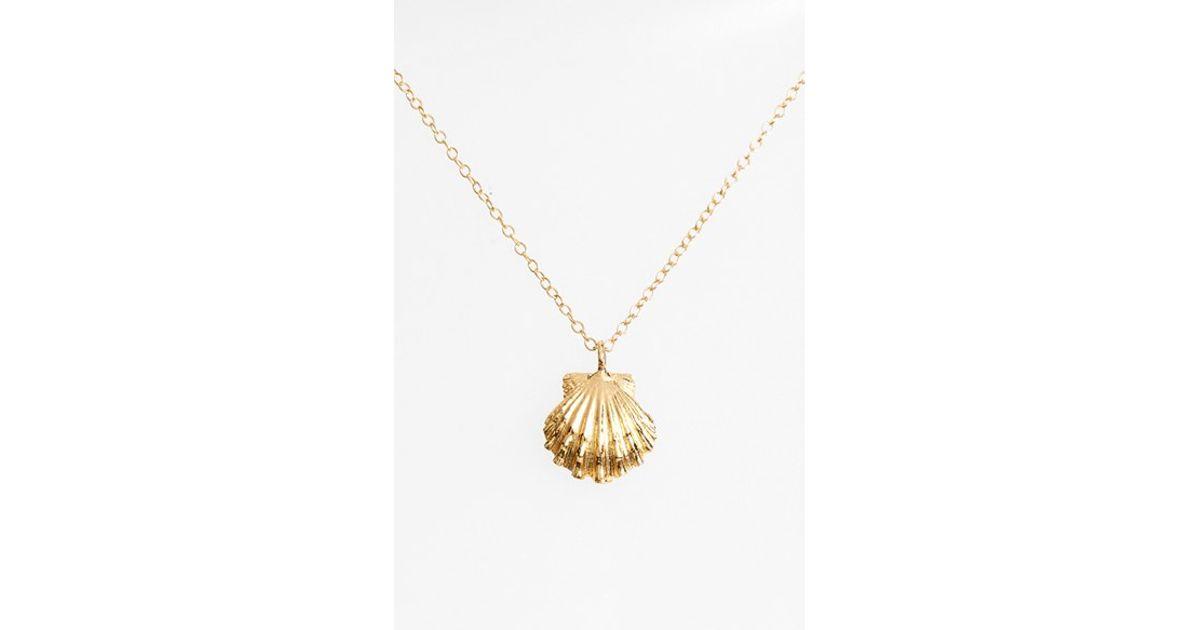 ki ele golden shell pendant necklace in metallic