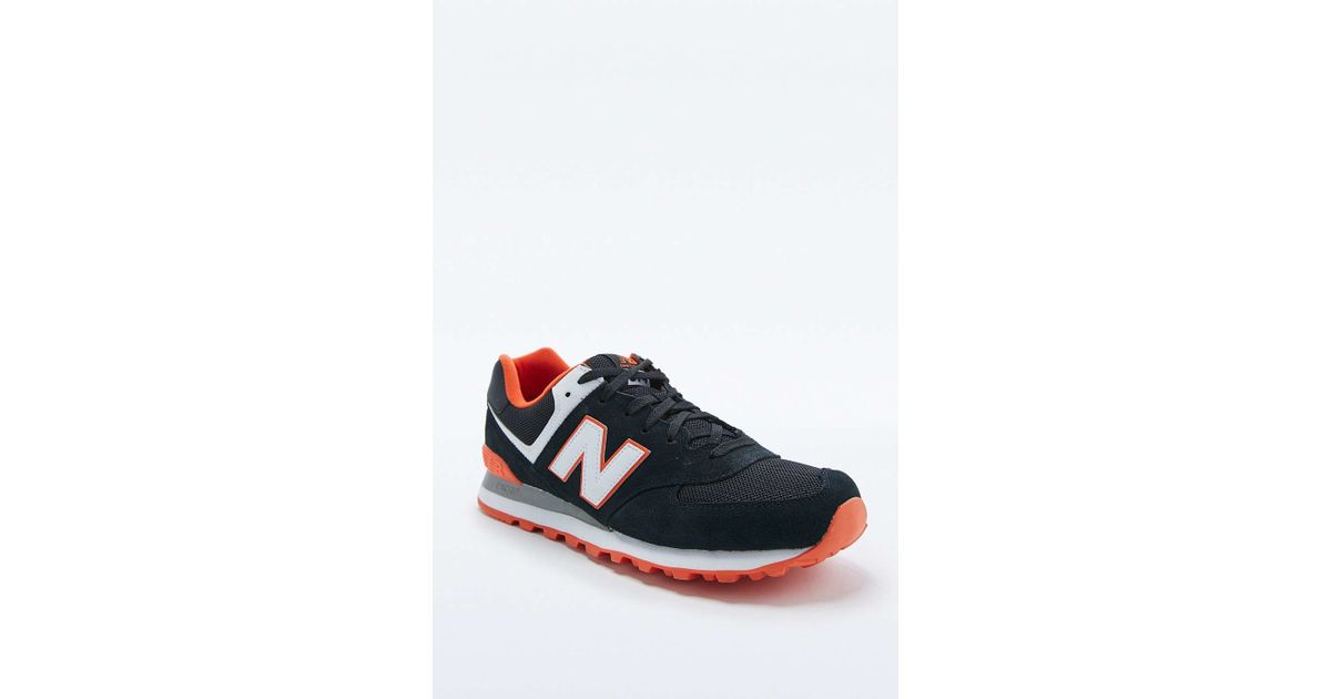 best cheap 4d57b d02a9 New Balance 574 Black   Orange Classic Running Trainers in Black for Men -  Lyst