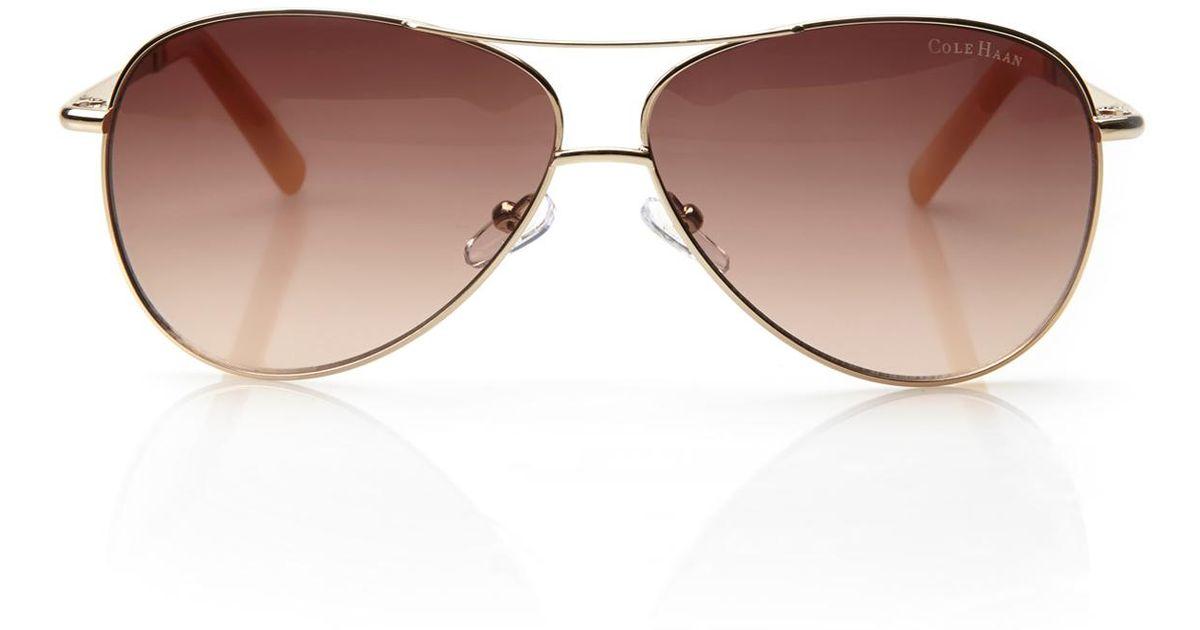 9674d1d9b5 Lyst - Cole Haan C669 Gold-Tone Aviator Sunglasses in Metallic