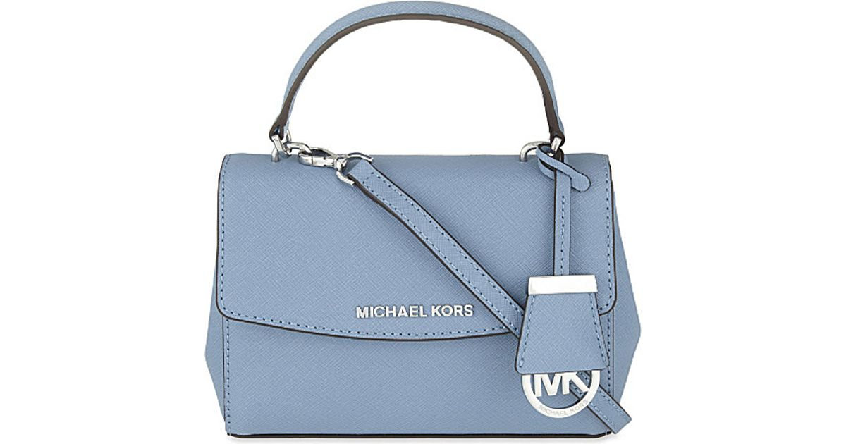 80b0d6956c39 ... closeout lyst michael michael kors ava extra small saffiano leather  cross body bag in blue fc911