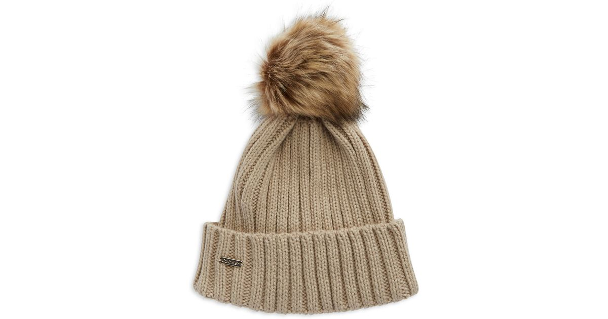 1bb2ecfe Calvin Klein Ribbed Knit Faux-fur Pompom Beanie in Natural - Lyst