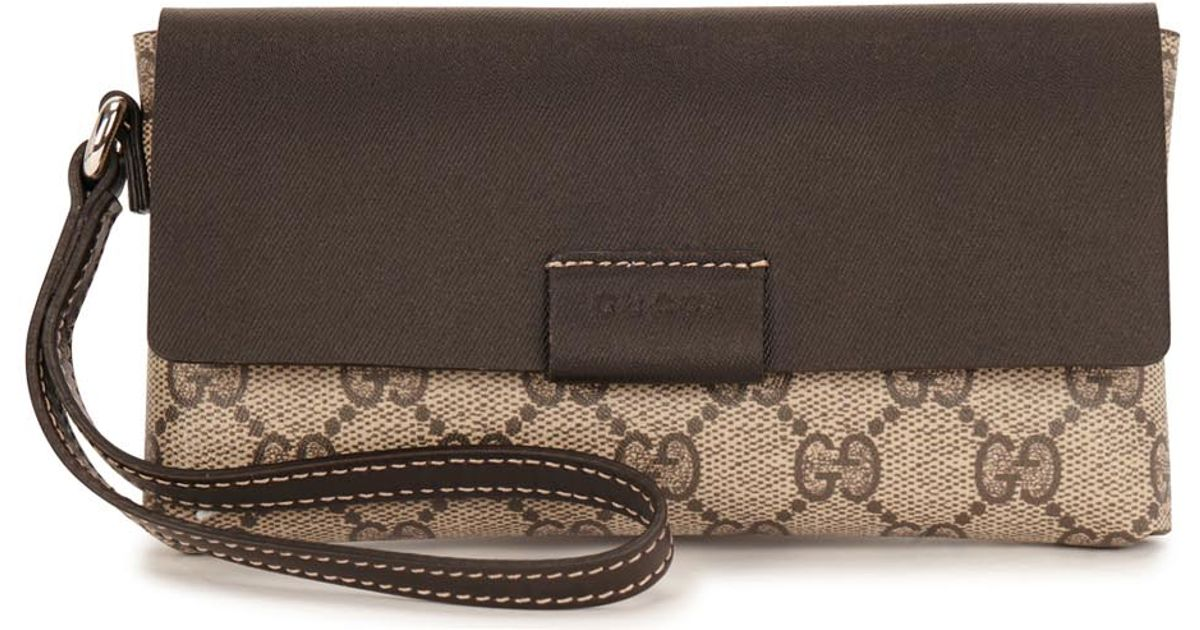 6542d43e2 Gucci Gg Monogrammed Faux Leather Clutch Bag in Natural - Lyst